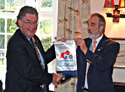 President Humphrey receives the RI Banner from DG George